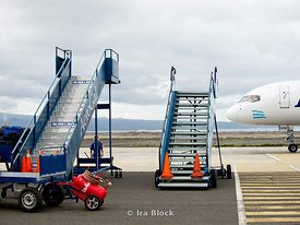 Runway stairs lined up waiting for the next arriving flights at Baltra aiport in the Galapagos.
