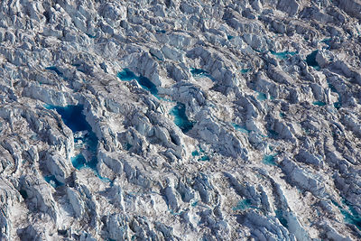Aerial view of crevasses with meltwater on the Sermeq Kujalleq Glacier or Jakobshavn Isbrae, near Ilulissat Icefjord UNESCO W...