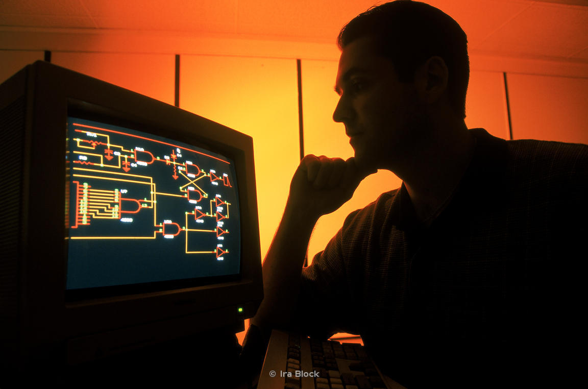 An technician working with electronic circuit design.