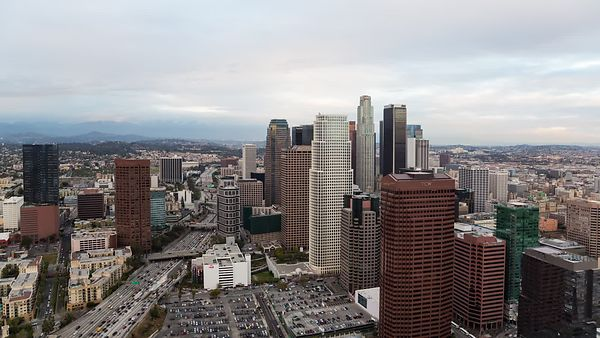 Bird's Eye: L.A. Skyline Electrified Under Nightfall (Day to Night)