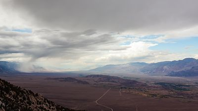 Bird's Eye: Racing Rainstorms Over An Enormous Mountain Valley