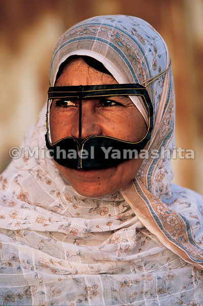 A woman of Musandam wears the traditional birka, or facemask, of Omani women.