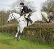 Dominic Gwyn-Jones jumping a hedge