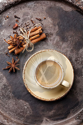 Coffee with spices on dark background