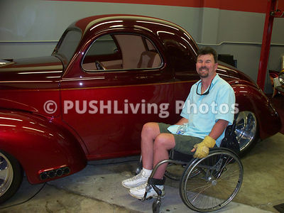 Man in a wheelchair with his classic car