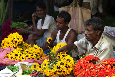 Workers prepare flower arrangements at the Howrah Flower Market, Kolkata, India, reputed to be the largest flower market in A...