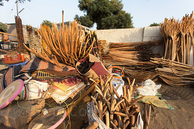 Hand made wooden pitchforks for sale to farmers at a market in Pushkar, Rajasthan, India