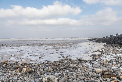 Pebble beach and sea foam