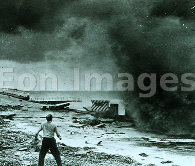 Man by seawall during Miami hurricane, 1947