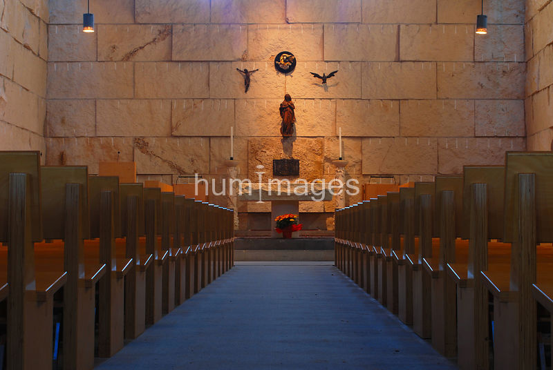 Center aisle in a Catholic church with communion table in front