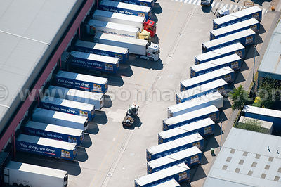 Aerial view of lorries and warehouse