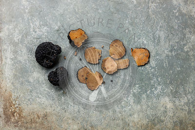 Sliced Black truffle on stone shale slate background