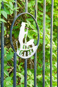 Symbol of the Gardeners' Royal Benevolent Society now Perennial, set into the garden gate. York Gate Garden, Adel, Leeds, Yor...