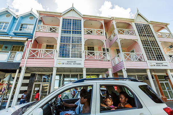 Family in a car in front of  Ministry of Legal Affairs in Castries, St Lucia