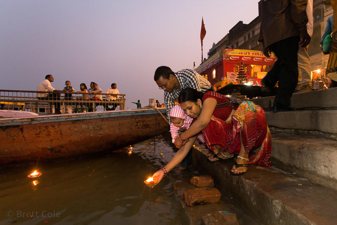 A woman releases a candle into the Ganges River, Dashashwamedh Ghat, Varanasi, India