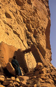 Hogon, spiritual leader, in his carved cliff home, Ende village, Dogon Country, Mali