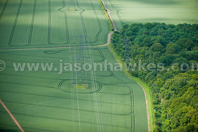 Aerial views of electricity pylons in fields in Hertfordshire