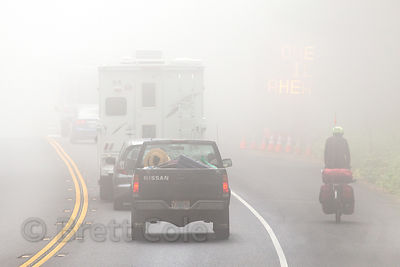 Traffic in morning fog near Del Norte Coast Redwoods State Park, California