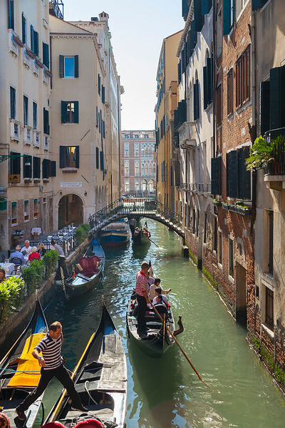 Italy, Venice, Gondolas in small side canal near St Mark's Cathedral