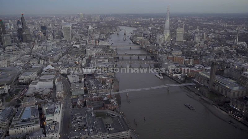 Arial footage of the River Thames between the City of London and Southwark