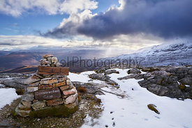 A conservation Cairn on Beinn Eighe with the summit of Creag Dhubh in the distance. Scottish Highlands, Scotland, UK.