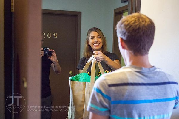 Leslie O'Hare, Founder/Chief Executive Mom of business start-up Your Campus Mom, LLC, acts out her grocery delivery service w...