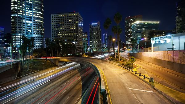 Medium Shot: A River of Rush Hour Lights & Overpass Reaching Through Downtown L.A.