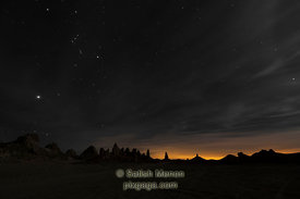 Trona Pinnacles and Starry Night, showing light pollution from nearby city, California, USA