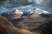 From the Ben Alligin, gark threatening clouds approach the summit of Liathach, Scottish Highlands.