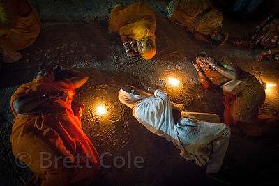 A group of elderly women Hindu pilgrms perform a ritual on the beach during the Gangasagar Mela, Sagar Island, India.