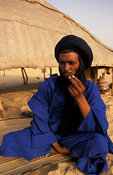 Tuareg smoking his pipe at a homestead in the Sahara desert, Timbuktu, Mali