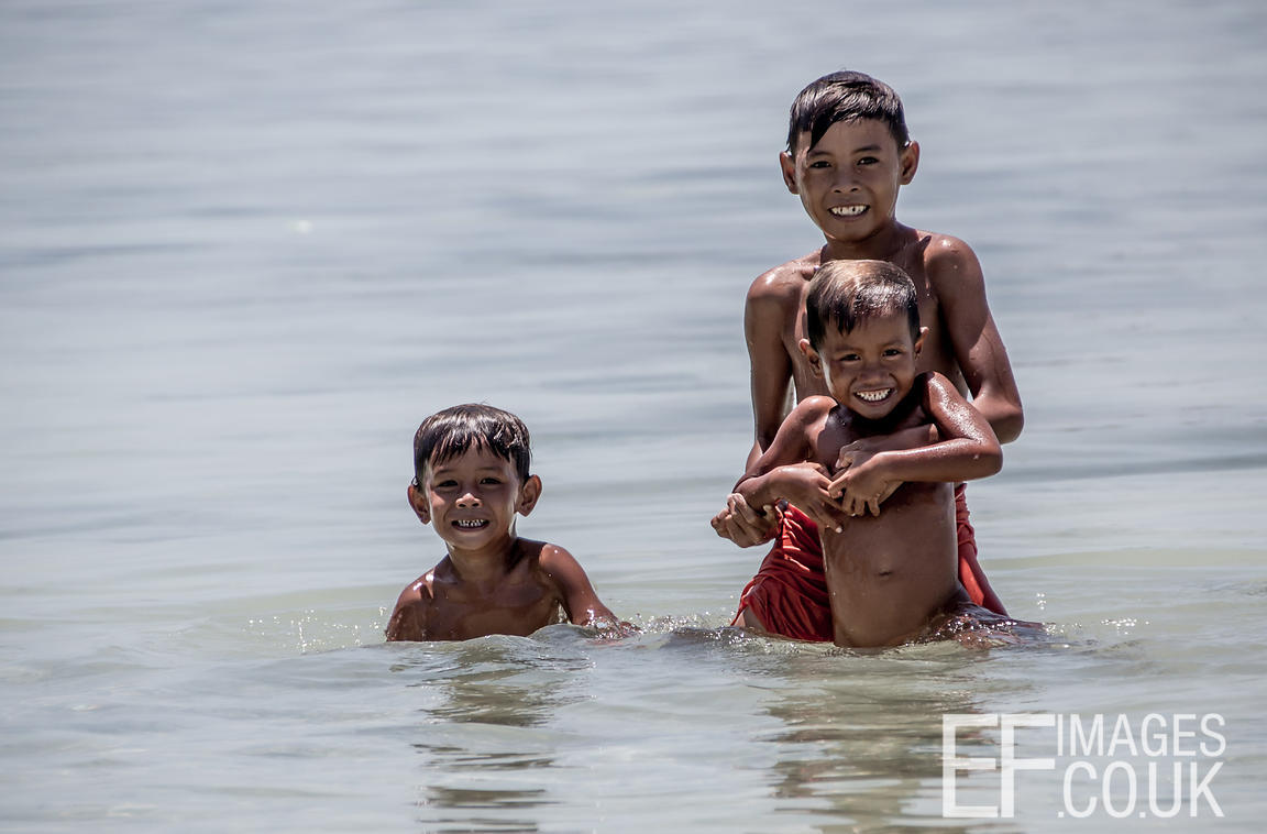 Sea Gypsy Children Playing In The Water