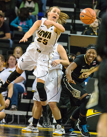 Iowa's Kali Peschel (25) and Purdue's Andreona Keys (24) vie for a loose ball during the second half of play at Carver-Hawkey...