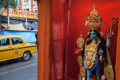 A pandal with an idol of the goddess Kali along a road in Newmarket, Kolkata, India.