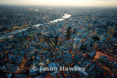 Over the City of London at dusk.