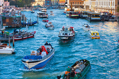 Italy, Venice, Morning traffic on Grand Canal at Venezia Santa Lucia Railway Station