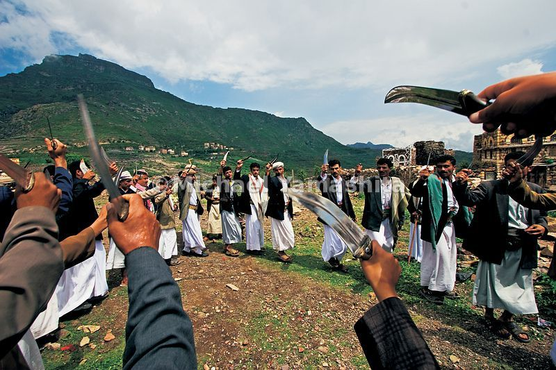 Wedding revelers in Al Hajirah dance while brandishing their jambiya, the ceremonial daggers worn by most Yemeni men.