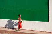boy walking past the mosque, Ilha do Mocambique, Mozambique