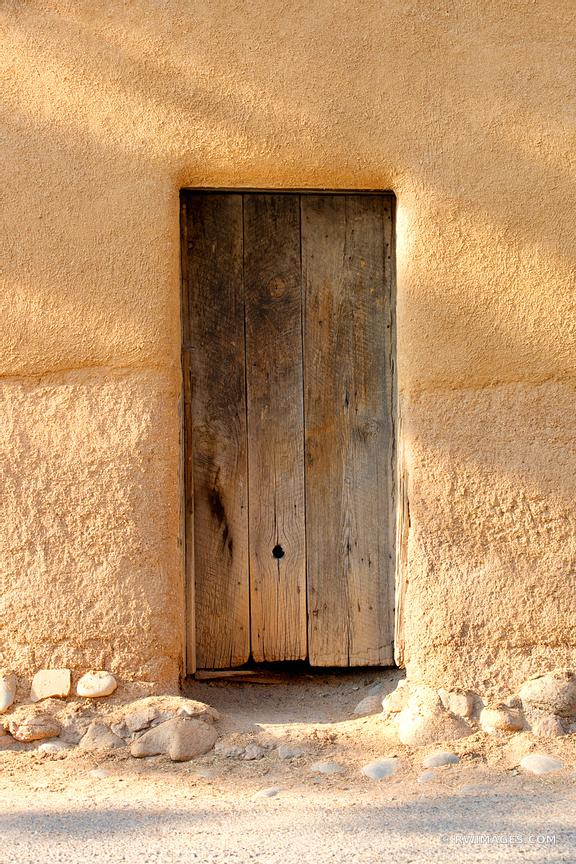 OLD WOODEN DOOR OLDEST HOUSE ADOBE BUILDING WALL SANTA FE NEW MEXICO