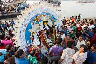 Durga Puja idols are immersed in the Hooghly River in Kolkata, India. The idols are statues of Hindu gods and goddesses that ...