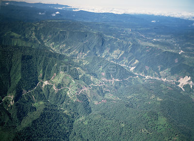 Aerial view of roads and deforestation on western slopes of Andes, Ecuador