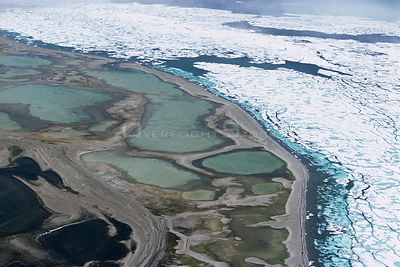 Aerial view of freshwater pools on the shoreline of the melting sea, Devon Island, Canadian Arctic