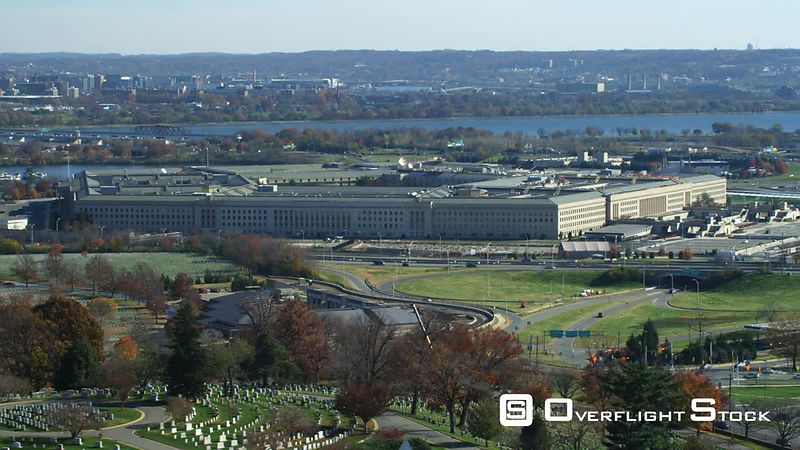 Flying over Arlington Cemetery past Pentagon  US Air Force Memorial passing across frame.