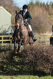 Zara Wise jumping the first hedge