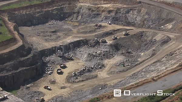 Aerial shot of vehicles working on an opencast mine Johannesburg Gauteng South Africa