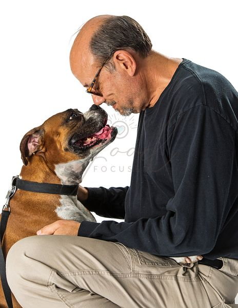 Man and Boxer Dog Looking at Each Other