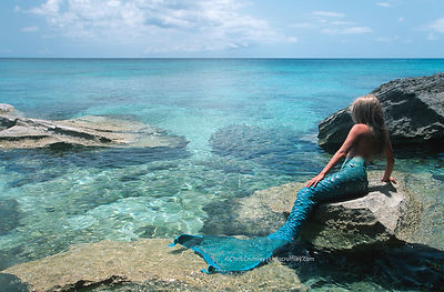 Mermaid on rock on tropical island, Northwest Point, Providenciales, Turks & Caicos Islands