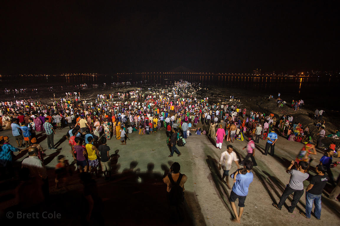 Thousands of people gather at Chowpatty Beach in Mumbai, India to immerse statues of Ganesh in the Arabian Sea during the Gan...