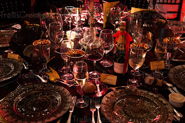 Beautiful rich dinner table setting with wine glasses