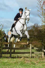Rosie Cass jumping a hedge near Little Dalby. Quorn Hunt Opening Meet 2018